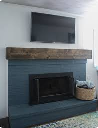learn how to build a simple diy fireplace mantel this rustic mantel has the charm