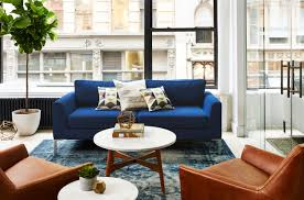 who makes west elm furniture. meanwhile our marco sofa in a fresh white upholstery makes more natural organic statement paired with green retro wing chairs and textural jute rug who west elm furniture d