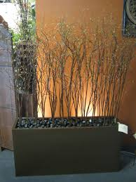 planter lighting. willow branches and river rock in planter boxes for deck decor i would add some lighting