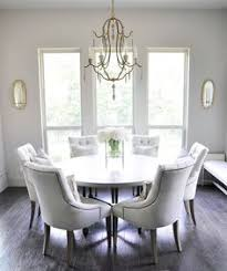 bright and sunny breakfast nook with round table