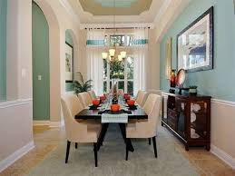 green dining room with chair rail. traditional dining room with crown molding, carpet, chair rail, high ceiling, limestone green rail