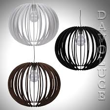 puffin 60 pendant with a white brown or black timber shade from domus