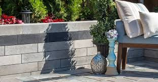 choosing the right material coloring and design for your retaining wall can make a huge impact on how it enhances its environment