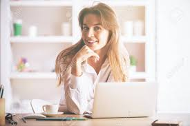 european cup office coffee. Portrait Of Cute European Girl Sitting At Office Desk With Laptop, Coffee Cup, Supplies Cup U