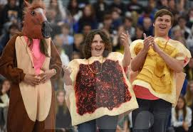 Juniors Kennedy Kauffman, Sophie Rice, and Charlie Birt show off their  costumes to promote the Halloween themed MORP. Photo by Julia Percy | The  Harbinger Online