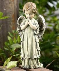 little boy angel garden statue and