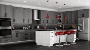 dark gray cabinets red bar stools maroon pendant lights double wall ovens french door refrigerator black stone flooring white island with granite countertop