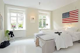 Minimalist Bedroom Minimalist Bedroom With White Walls And Bedding Also Hanging Bulb
