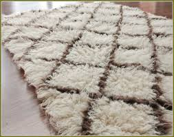 impressive area rug over berber carpet home design ideas intended for berber area rugs attractive