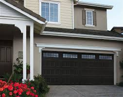 self expression shouldn t cost a fortune with amarr s oak summit collection it won t amarr s most affordable carriage house door built with the amarr