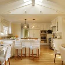 Pitched roof lighting ideas Rear Spacious White Kitchen With Vaulted Ceiling Homeroofideasinfo Photos Hgtv