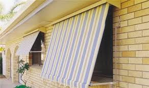 light colored automatic rollup outdoor blinds rolled down