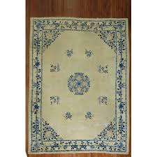 white blue chinese distressed rug