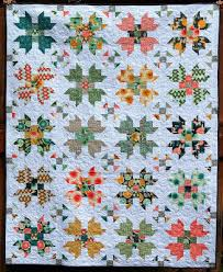 Happy Quilting: Florabelle Bloom - A New Finish and Quilt Tutorial & The Flroabelle Quilt finishes at 66