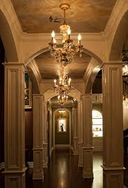 crystal mini chandeliers add a touch of glamour to small spaces a series of three mini chandeliers guide guests along this corridor