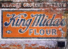 a vintage brick wall advertisement painted on the side of the old krause grocery