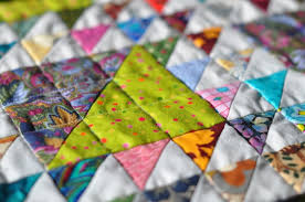 On the Grid - Lynn Carson Harris & I've been doing a little quilting on the Lady of the Lake- stitch in the  ditch. Adamdwight.com