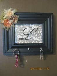 Custom key rack - so easy to make! Spray painted frame, scrapbook paper with