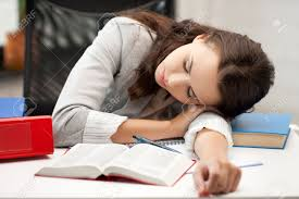 weakness images stock pictures royalty weakness photos and weakness bored and tired w sleeping on the table stock photo