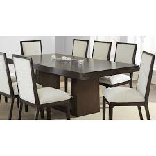 the modern cly amia dining table features a gorgeous deep espresso finish capable of expanding using the removable leaf this elegant trestle table is