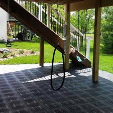 staylock perforated outdoor flooring over grass garden deck tile