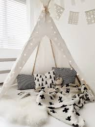 View in gallery Teepee reading nook with clean colors, patterns, and  lantern lights