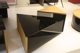 a similar design is their triangular coffee table set that includes pieces of various heights