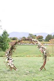 romantic summer outdoor winery wedding with wooden arbor available for by paisley and jade