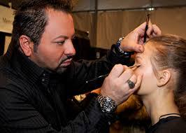napoleon perdis applying makeup