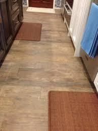 floor design amusing home interior and flooring ideas using dark brown kitchen mat including black wood island light porcelain tile that looks hardwood