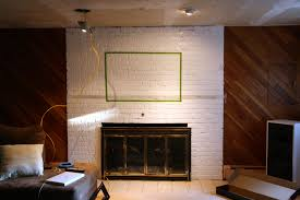 how to hide cables when mounting tv over brick fireplace image