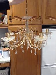 cut glass 5 bulb chandelier also have 3 bulb and 4 wall lights in same design all in excellent