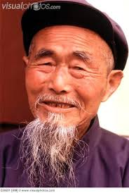portrait of old chinese man with wispy bear wearing a mao style jacket and cap china