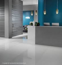 glossy and matte floors neutral bases brought to life by accents of color on the walls