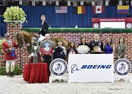 Jos Verlooy and Sunshine Victorious in $25,000 The Boeing Company Puissance  at the 2015 Washington International Horse Show