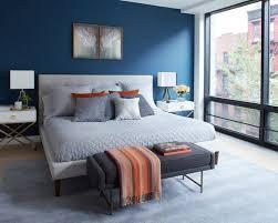 trendy bedroom furniture. example of a trendy light wood floor and beige bedroom design in new york with furniture
