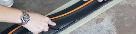 the garage door floor seal is a great solution to keep wind n dust leaves and water from entering the garage under a poorly sealed garage door thus