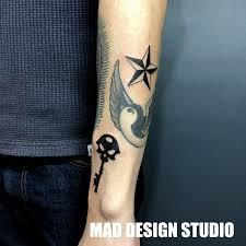 星と鍵のタトゥー Mad Design Studio