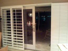 plantation shutters sliding glass door for doors with built in bypass over