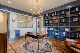 greenfront furniture with traditional home office also built in blue bookshelves dark wood desk framed art