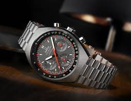 3 new omega seamaster and speedmaster watches › watchtime usa s omega speedmaster mark ii gray orange reclining