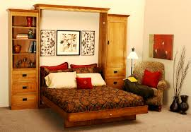 furniture for small spaces bedroom. Pull Out Bed For Small Spaces Along With Wooden Cabinet Also Drawers Single Sofa Furniture Bedroom