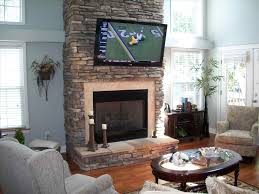 fireplace designs with tv above room with tv above fireplace decorating ideas modern cabinet stone mantel
