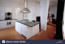 Limestone Flooring Kitchen White Island Unit In Openplan Kitchen And Dining Room With
