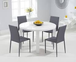 ava 120 round high gloss table 4 grey ava stackable chairs