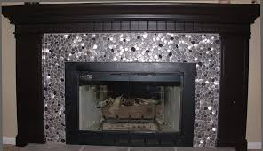 if you are thinking of remodeling your fireplace surround consider using a metal tile for your project it may well become a conversational centerpiece