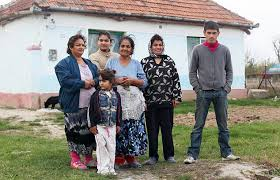 romanian people. basic conditions: daniel neda, left, and family outside their home romanian people
