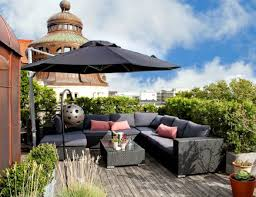 rooftop furniture. Exterior:Sleek Rooftop Patio Design With Wicker Furniture Set And Black Parasol Designing The Best F