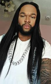 a picture of an african american male with long straight hair which he styled across