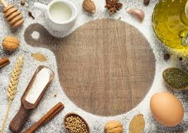 Cutting Board And Bakery Ingredients On Wooden Background Stock